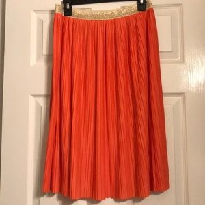 Cute coral skirt with gold trimming